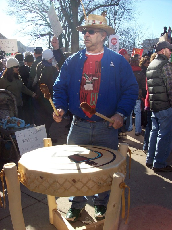 Drummer Playing Native Drum Outside of Capitol