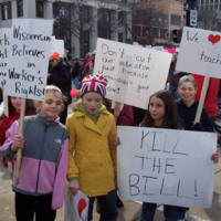 Elementary students with protest signs