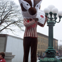 """Person in a Bucky Badger costume with a sign that reads """"Bucky supports the TAA and all unions"""""""